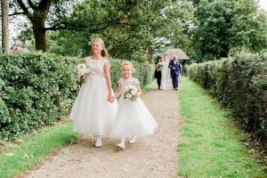 bridesmaids walk down path at norcliffe chapel