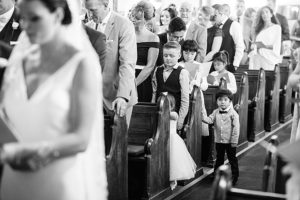 cut boy at wedding ceremony with bow tie