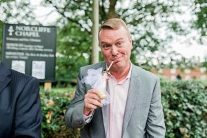 wedding guests drink champagne with straws