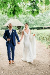 bride and groom at norcliffe chapel in styal