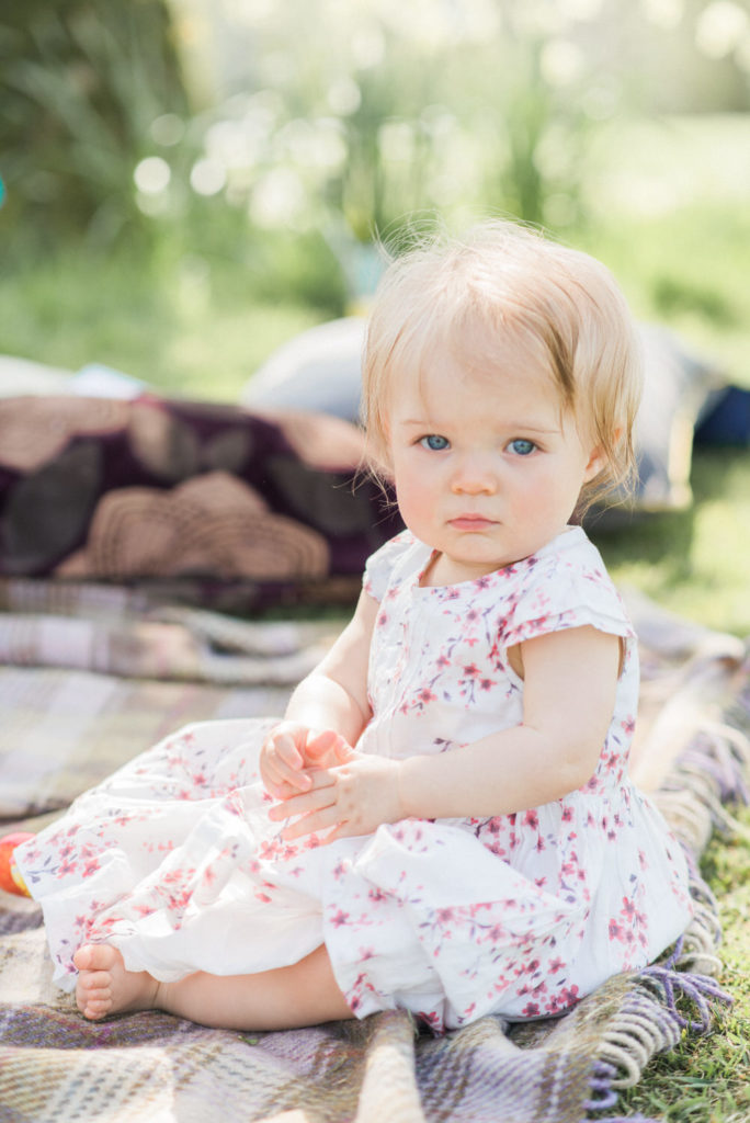 baby girl on picnic rug
