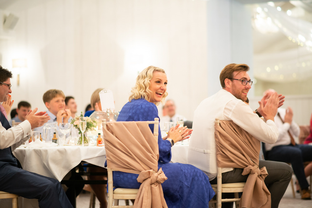 guests laugh at speeches