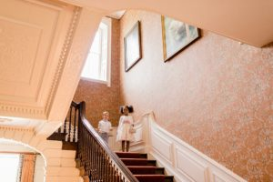 page boy and flower girl on stairs at Ardington House