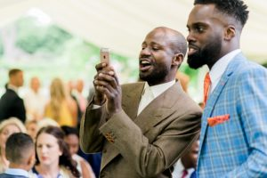 wedding guest taking photo on phone