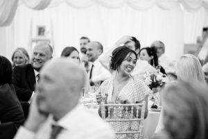 wedding guest laughs at speeches