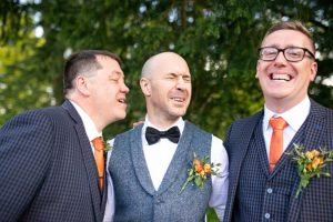 silly groomsmen pulling faces