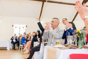 wedding guests applaud speeches
