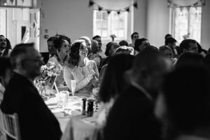 guest captured between rows of trestle tables