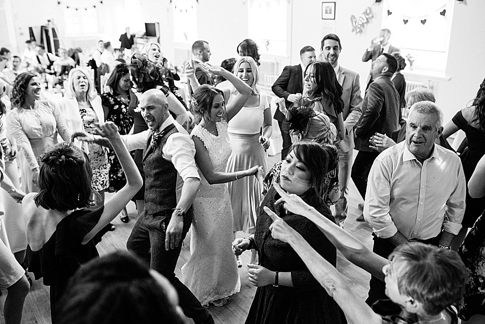 first dance with lively wedding guests