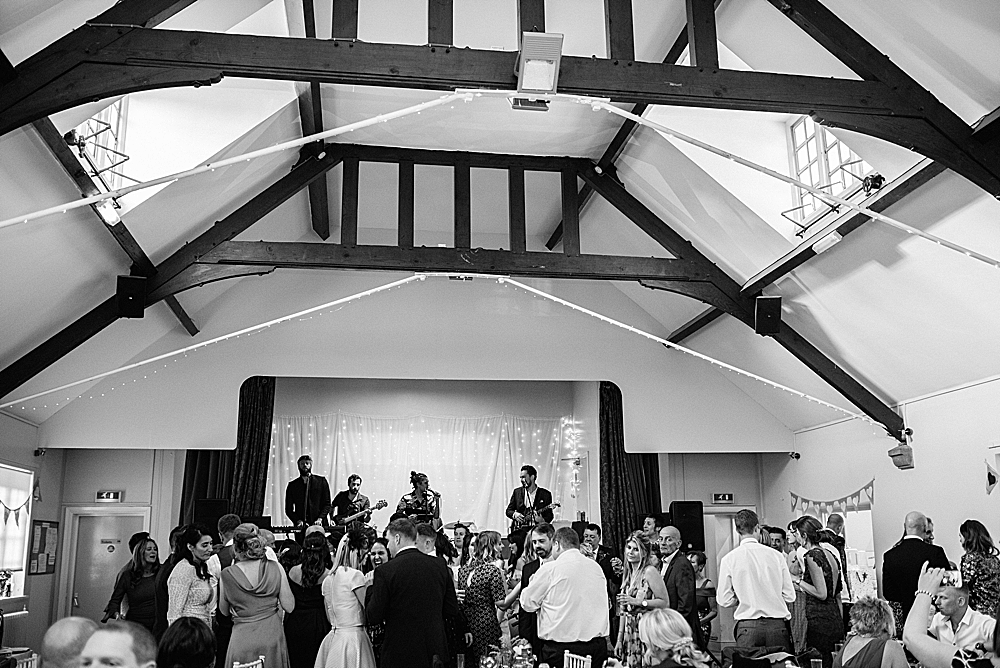 band playing on stage at Eccleston Village hall wedding