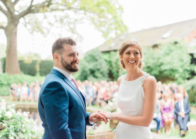exchanging wedding rings outdoorsoutdoor wedding ceremony
