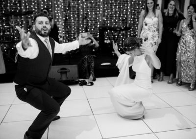 bride and groom first dance squats