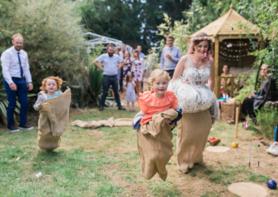 bride and children having a sack race