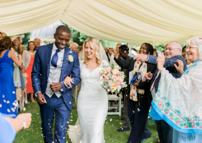 bride and groom leave ceremony at Ardington House
