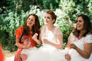 bride sitting with friends