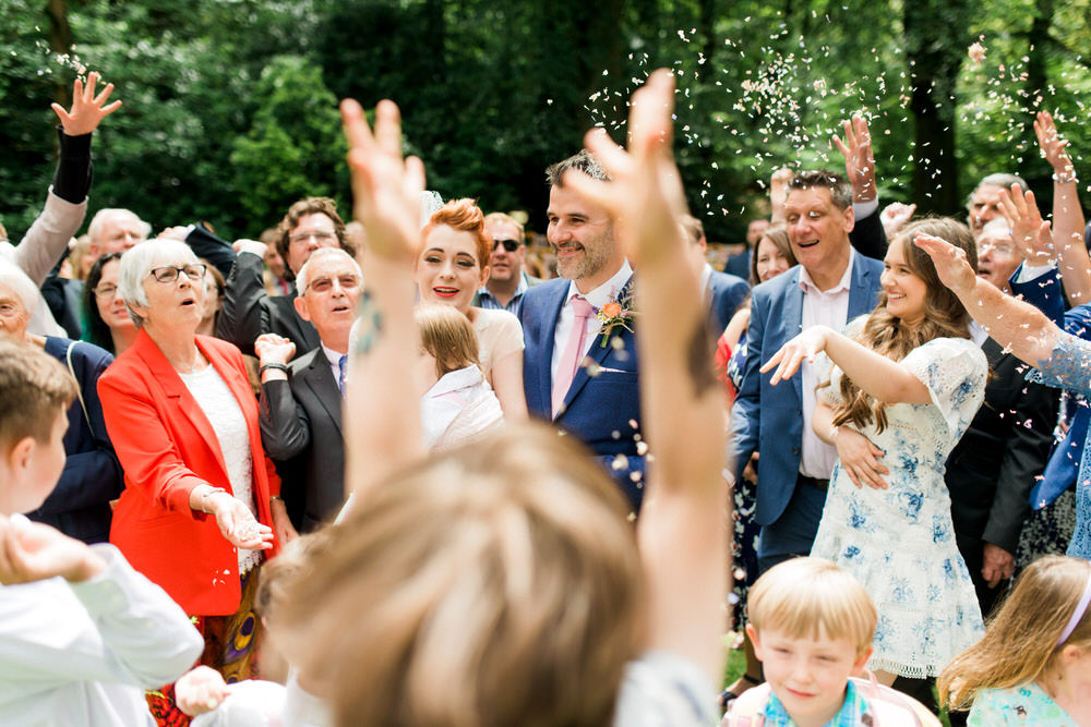 confetti throw at festival wedding