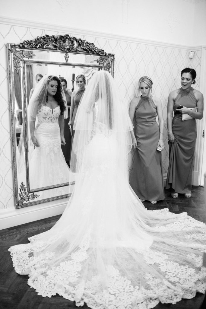 bride in front of mirror at home in birkenhead