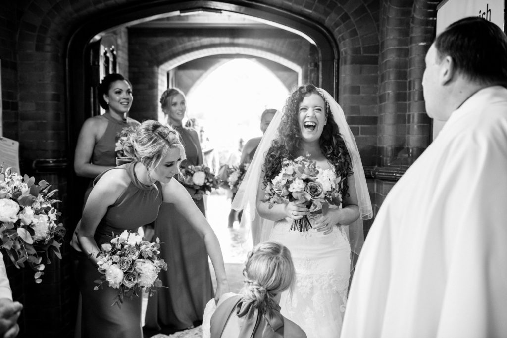 bride laughing as she arrives at st Josephs church birkenhead
