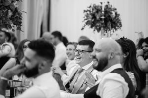 guest laughing at a marquee wedding