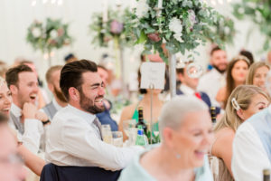 guest laughing at wedding speeches