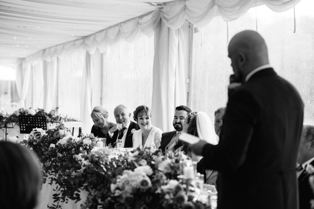 mother of the bride laughs at best man's speech