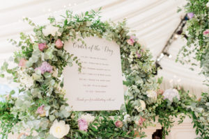 order of the day sign with flower frame