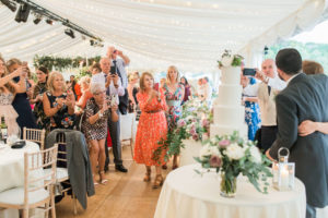 cutting the cake at marquee wedding