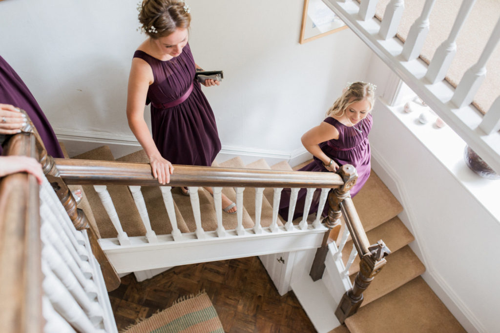 bridesmaids coming down the stairs at wyresdale park