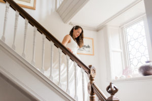 bride coming down the stairs at wyresdale park