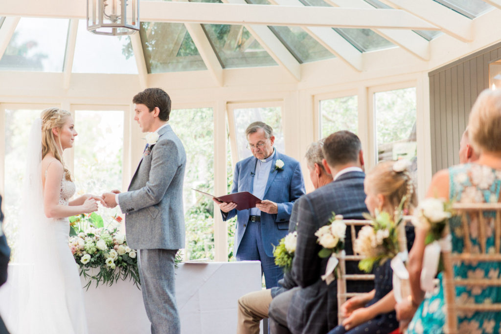 father of the groom leads blessing at bay tree at Burford