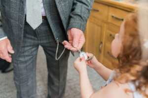flower girl looking at pocket watch