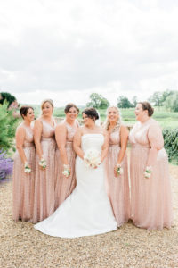 bride and bridesmaids wearing sparkly pink at Walton hall wedding