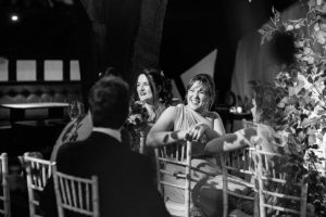 bridesmaid laughing during wedding ceremony