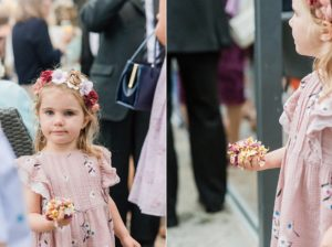 little girl with flower crown holding confetti