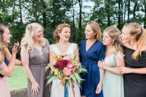 bride laughs with her friends