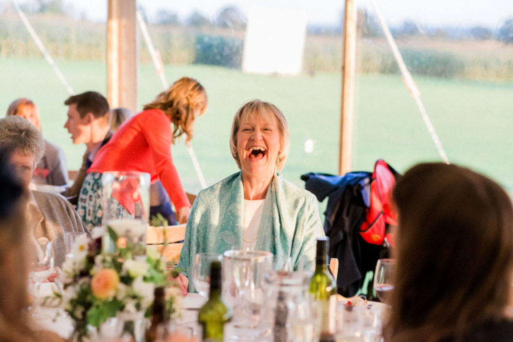 wedding guest in marquee laughing