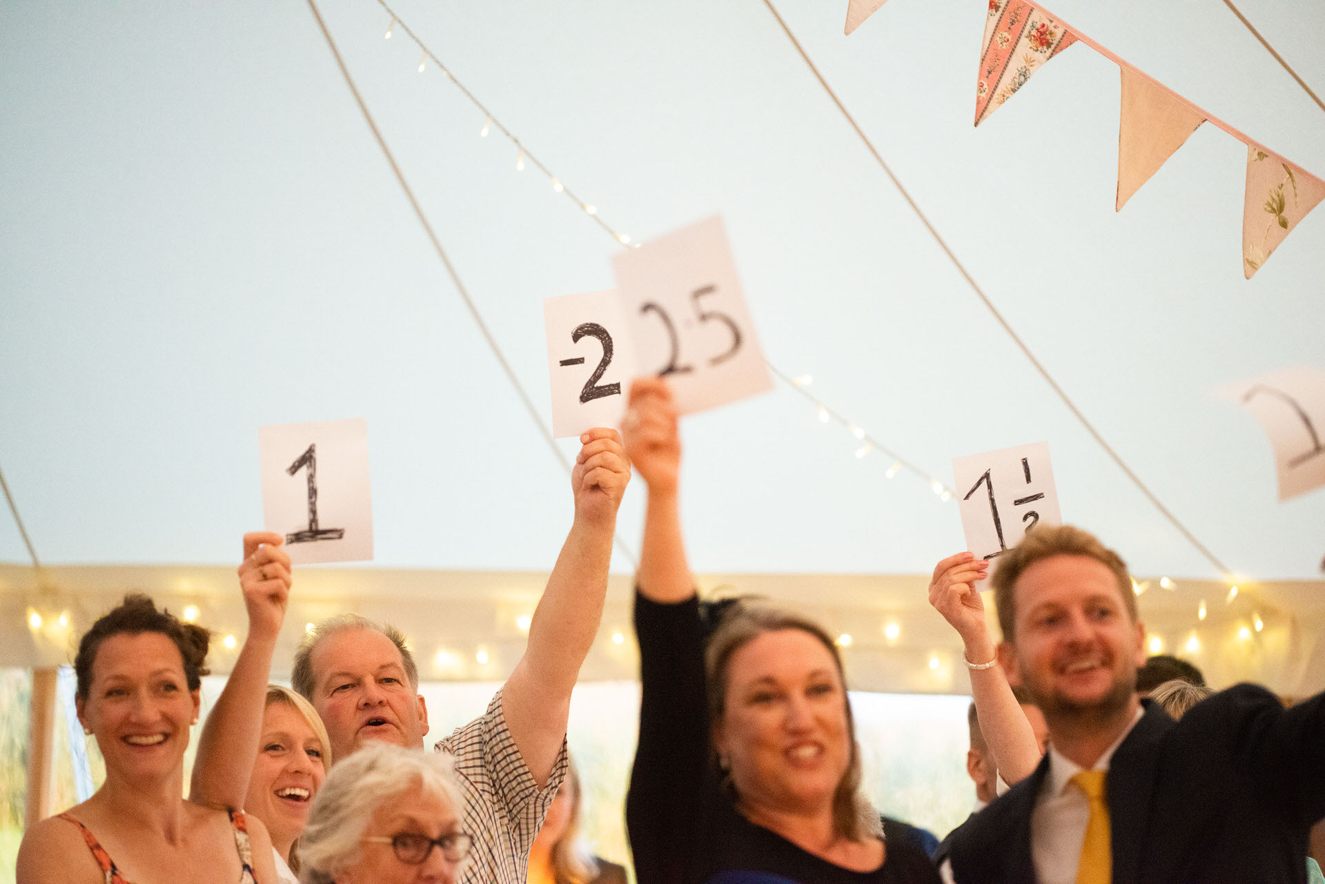guests holding up scores for speech