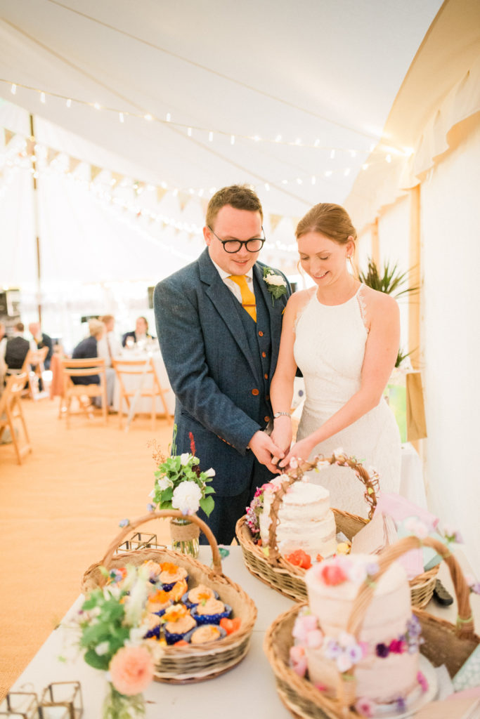 cutting the cake in a marquee