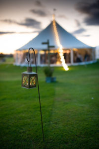 candles light the path to marquee