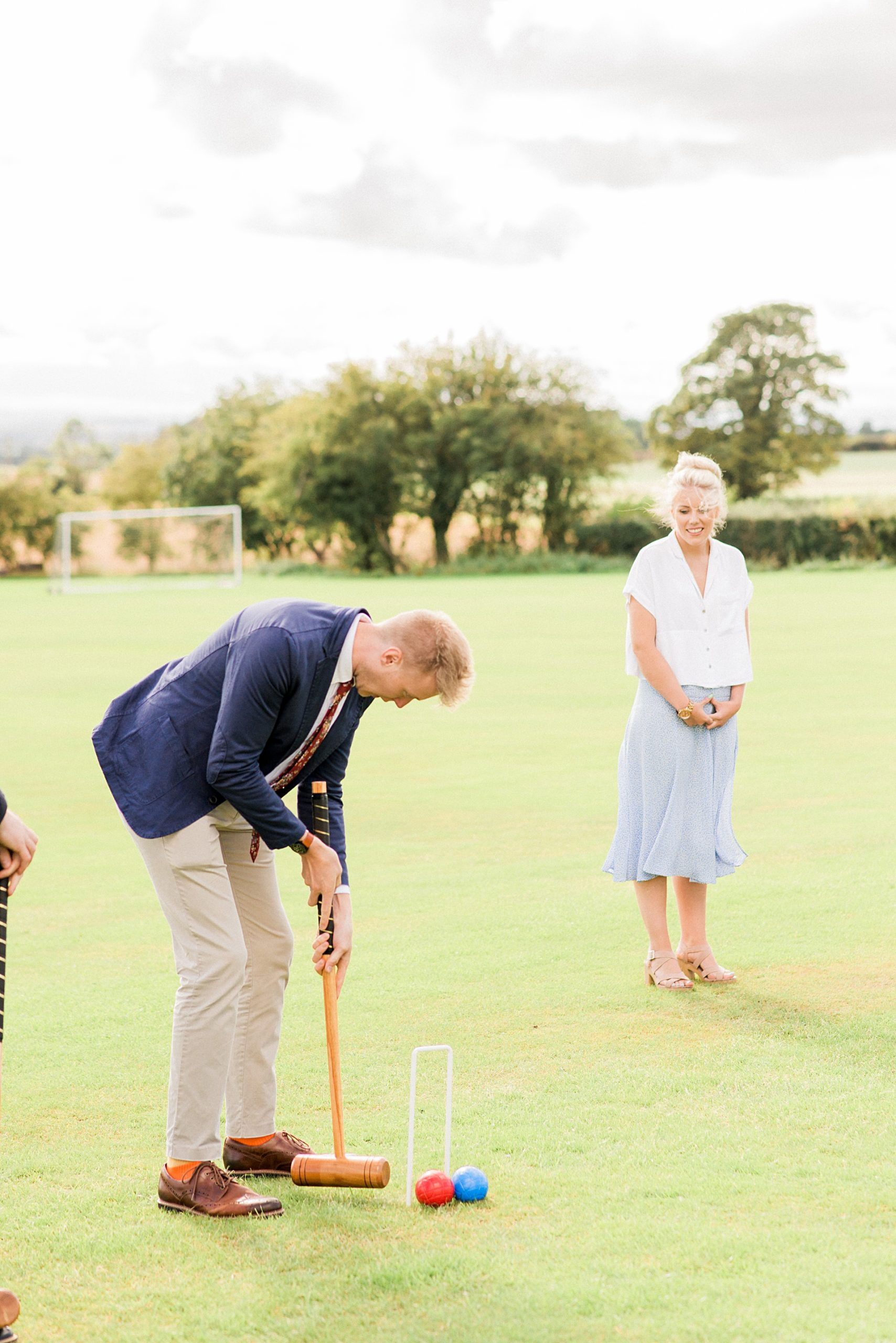 wedding guests playing croquet