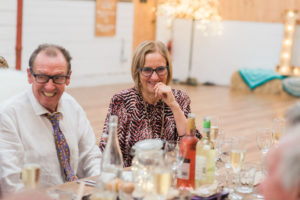 mother of the bride laughs at speeches