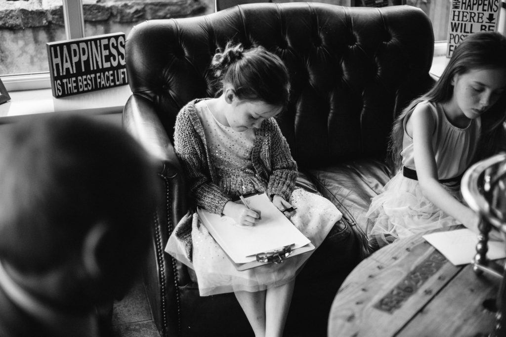 little girl drawing at wedding