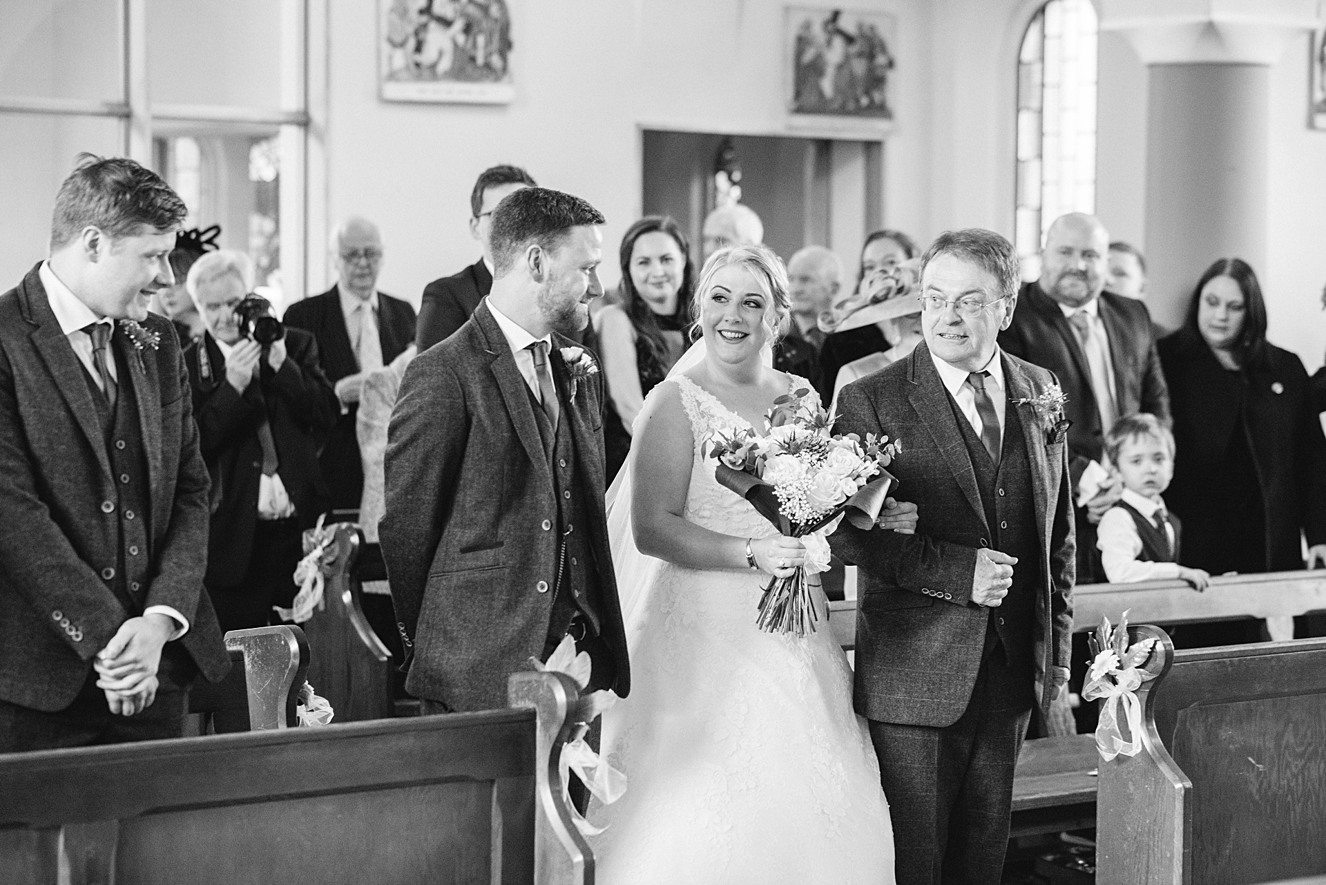 bride and her dad walk down the aisle to groom