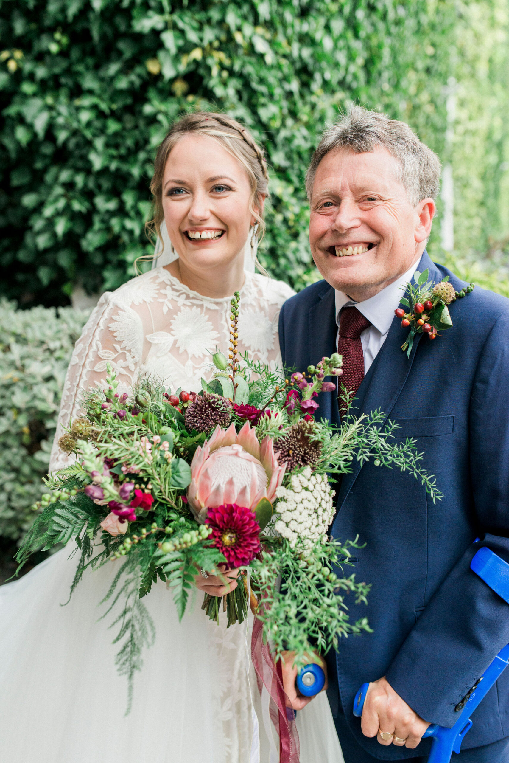 bride and her dad smiling
