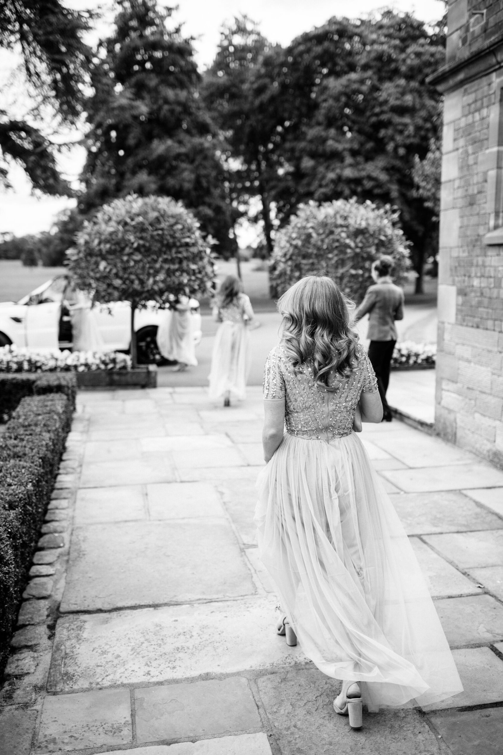 bridesmaid walking to car