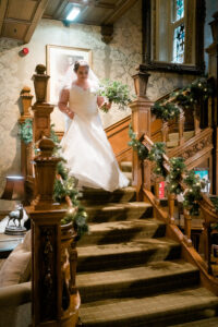 bride coming down the stairs at the merewood