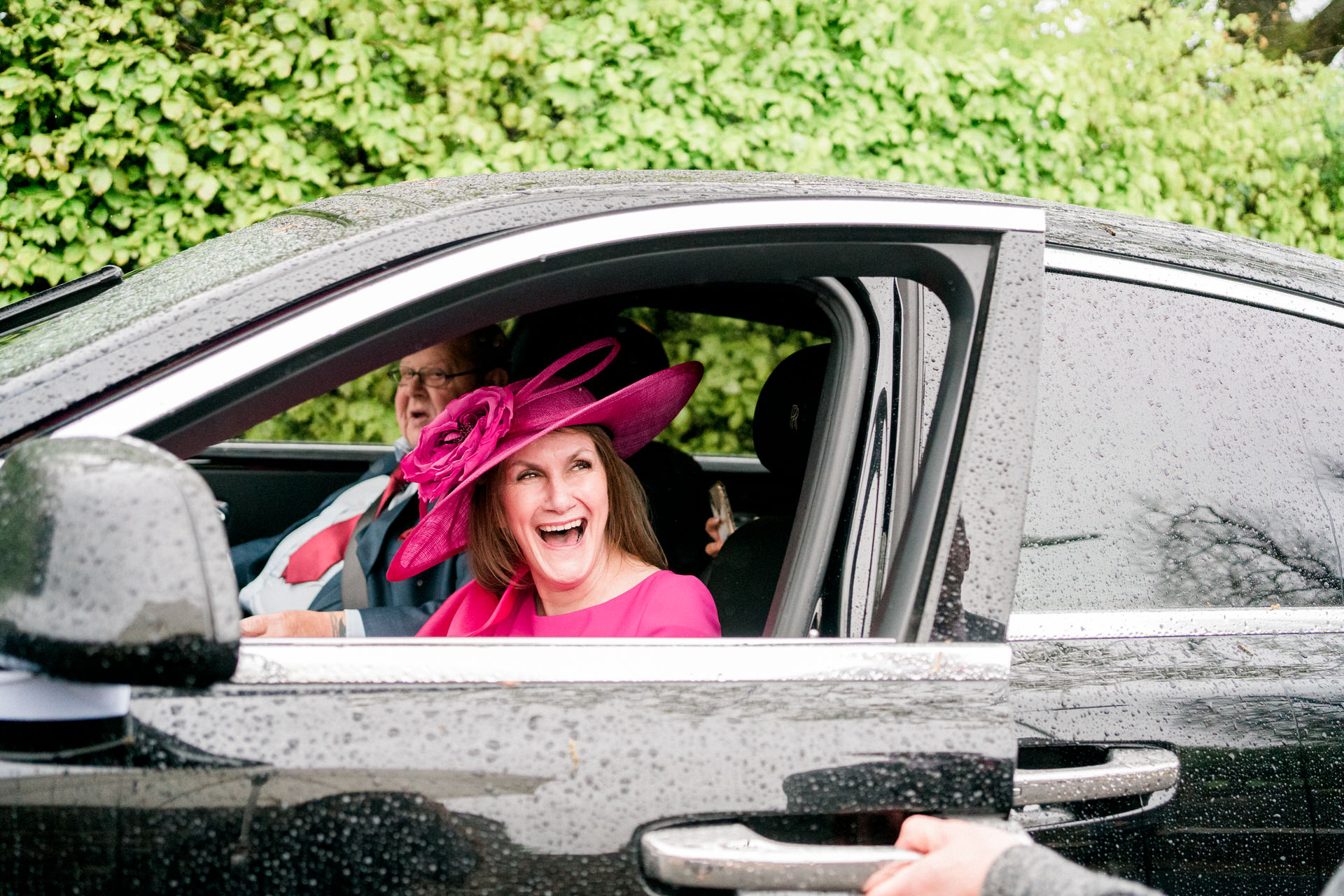 mother of the groom in wedding car