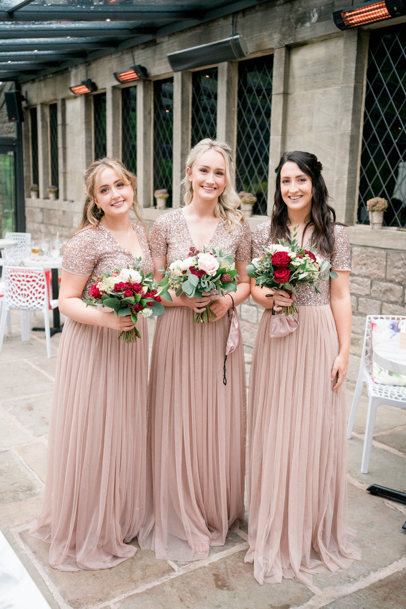 bridesmaids in pink with red roses