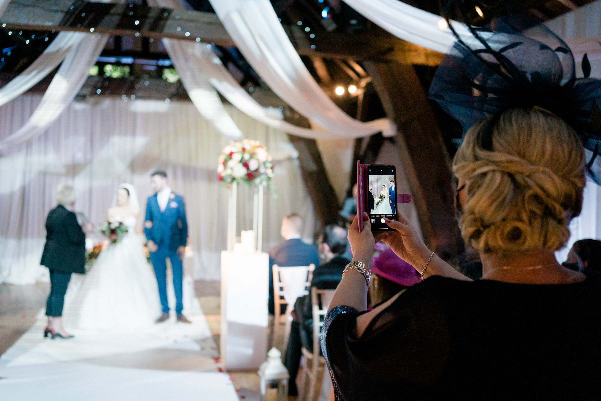 guest taking a photo at wedding