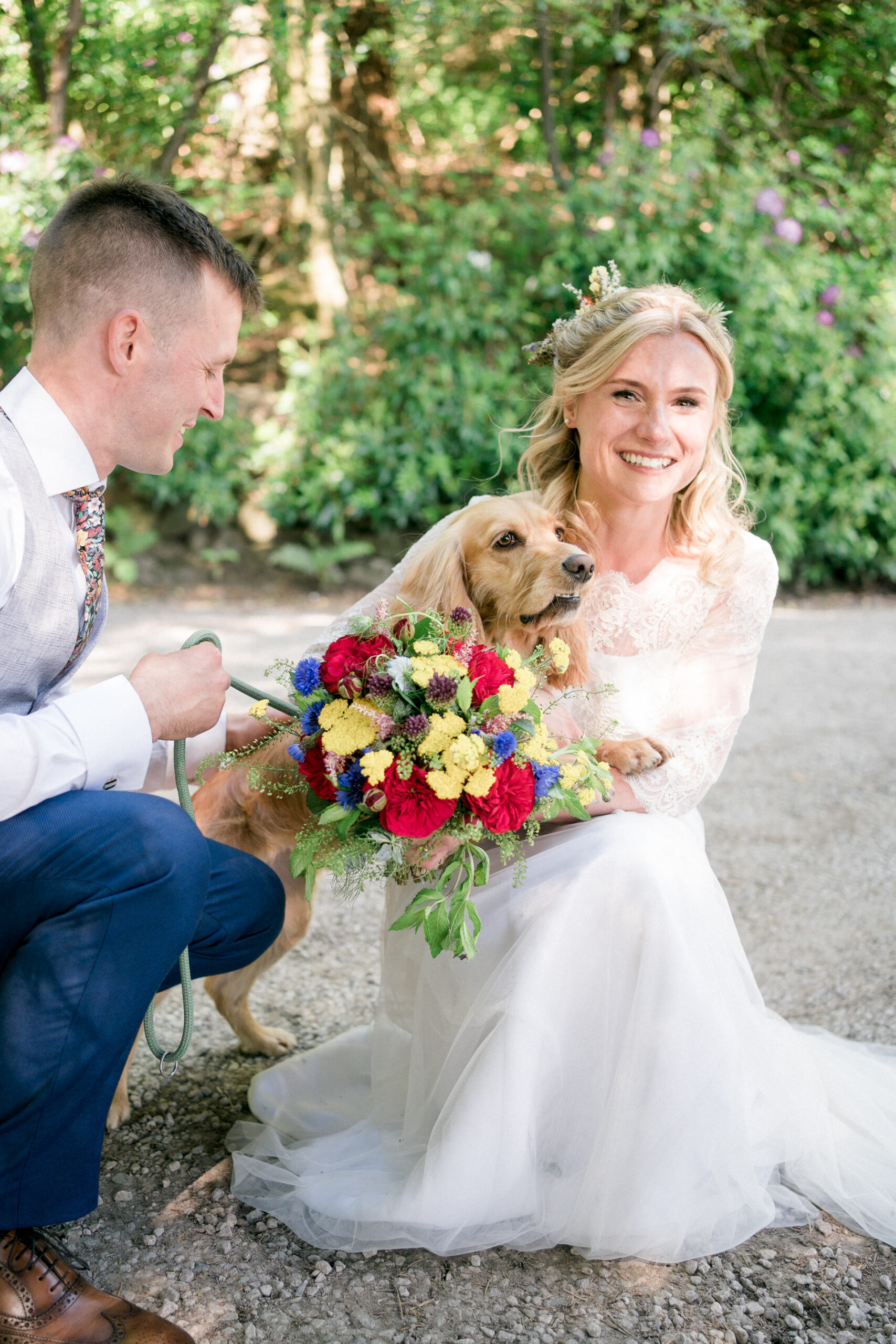 dog at wedding with bride and groom